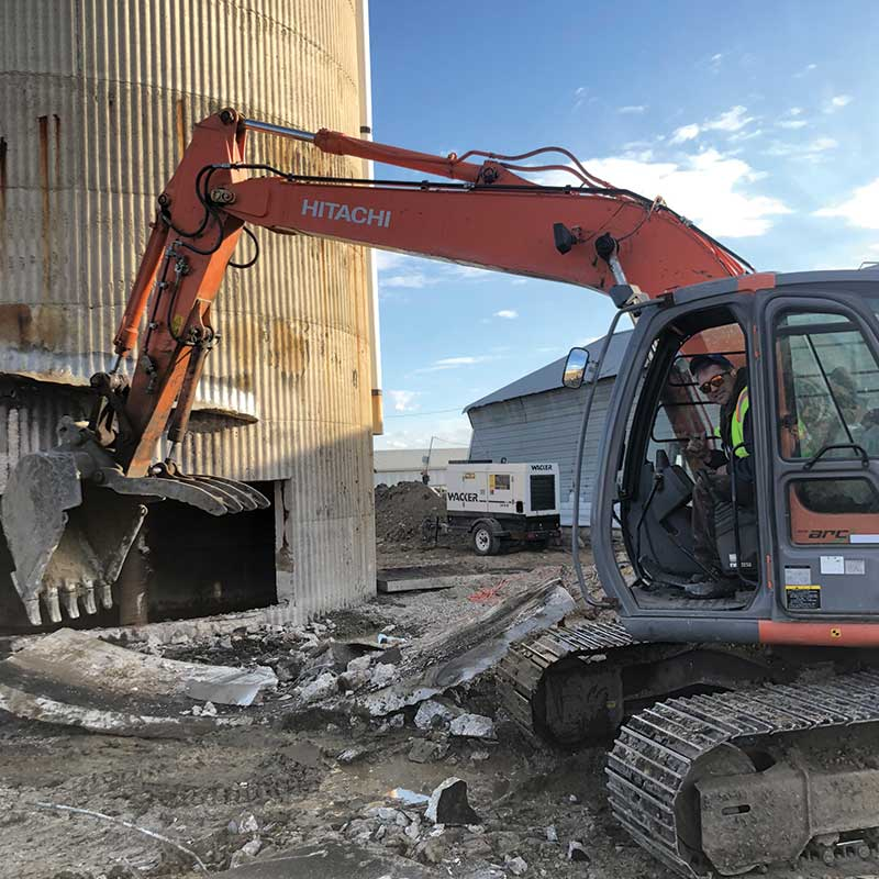 Concrete demolition contractor walser contracting in edmonton taking down a tower