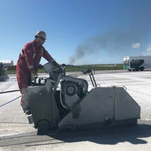Concrete cutting edmonton - image of technician from walser contracting cutting cement