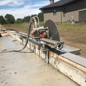 Concrete cutting Edmonton - image of concrete saw cutting a home foundation