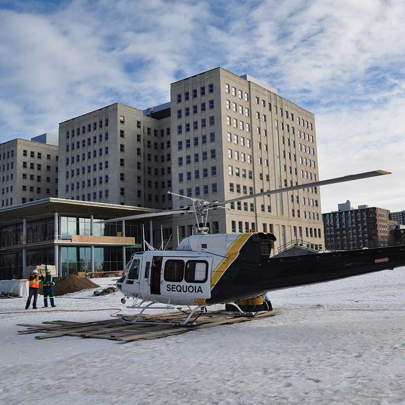 image of Helicopter concrete construction in edmonton by walser contracting - image of grounded helicopter
