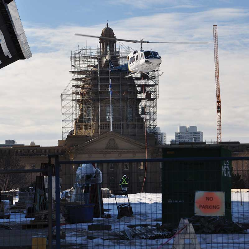 image of Helicopter concrete construction in edmonton at legislature grounds by walser contracting